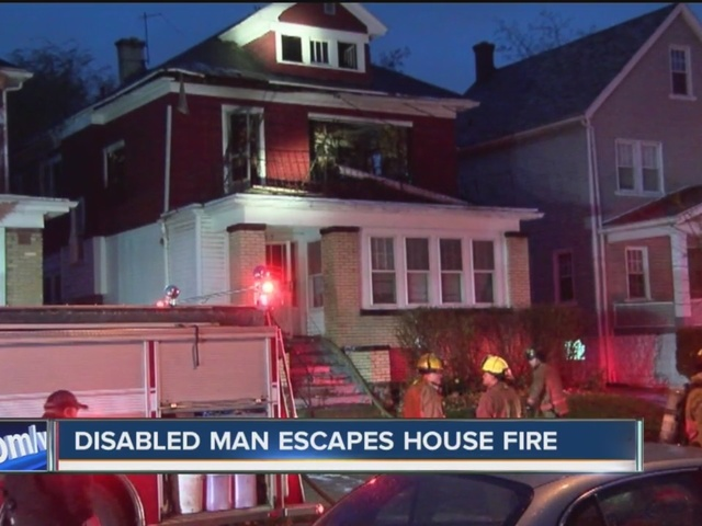 two strangers help disabled man escape fire