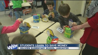 Second graders learn math by managing finances