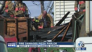 Metal bars challenge crews battling blaze