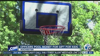 Police buy neighborhood kids new basketball hoop