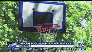 Police buy neighborhood kids new basketball hoop