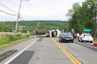 Driver causes crane truck to tip over