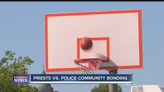 Priests and police play basketball to bond