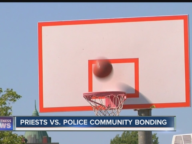 Police and priests play basketball
