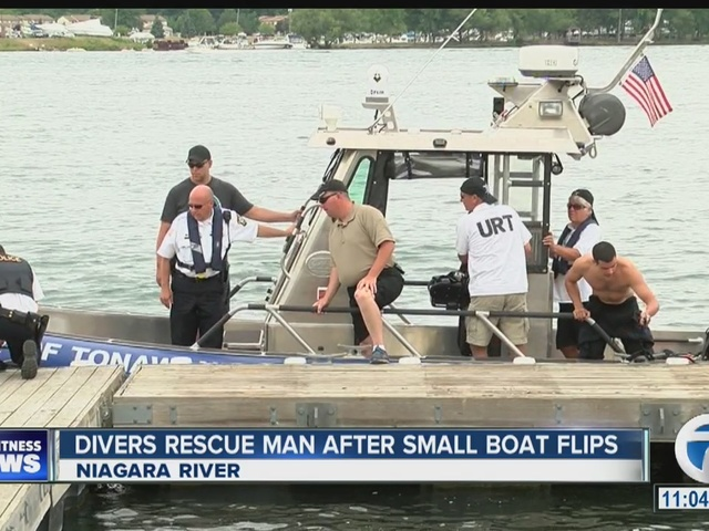 Divers rescue man after small boat flips