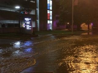 Water main break floods road near hospital