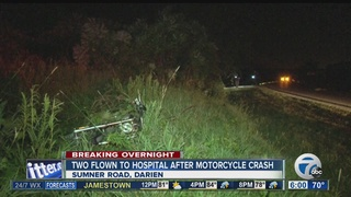 Two people thrown from motorcycle after crash