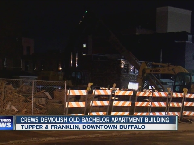 Crews demolish old Bachelor Apartment Building
