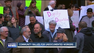 Supporters stand by workers arrested in ICE raid