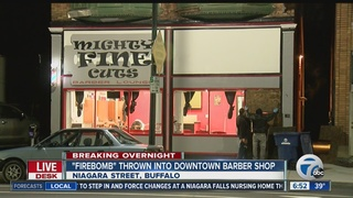 Suspected firebomb thrown through barber shop