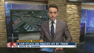 Car stuck in snow, hit by train in Dunkirk