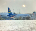 Icy conditions cause plane to skid off taxiway