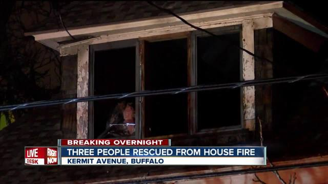 Buffalo firefighters rescue three from burning home