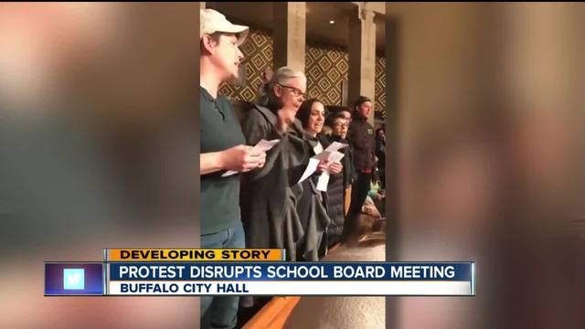 Protesters bring school board meeting to stop