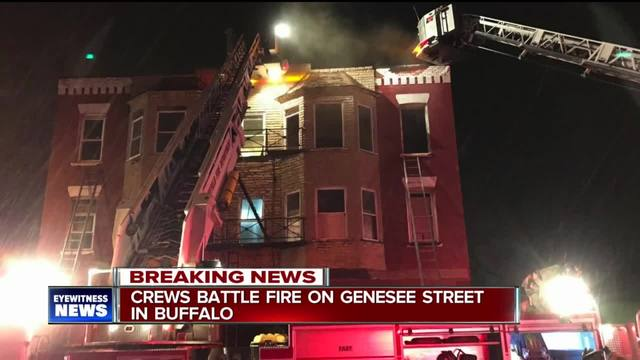 Two people escape apartment building fire