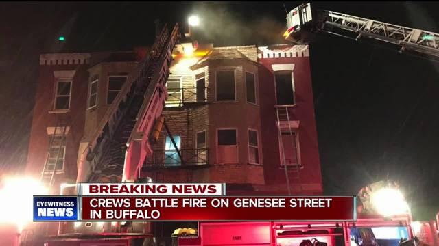 Two people escape apartment building fire