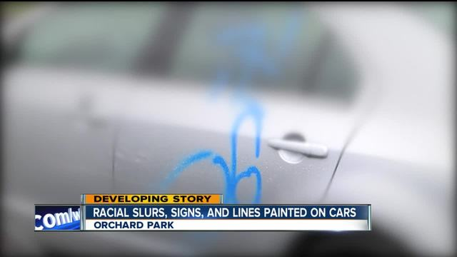 Racial slurs- signs- and lines spray painted on cars- railroad bridges-…