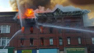 Crews battle massive fire in Falconer