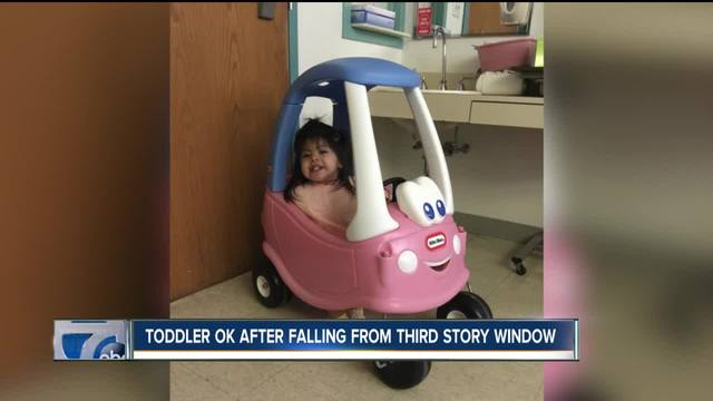 One year old falls through third story window in for 2 year old falls out of window