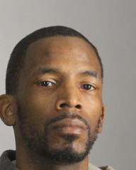 Wanted man found with stolen handgun