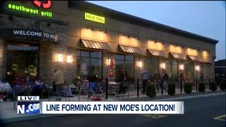 People line up at Moe's to score free burritos