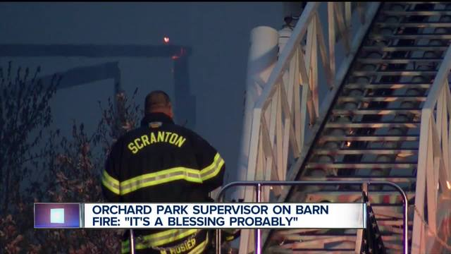 Fire crews battling massive barn fire in Orchard Park
