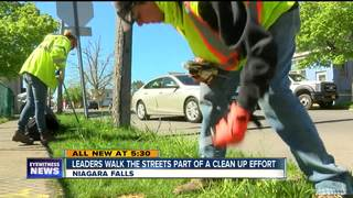 Leaders walk the streets, part of cleanup effort