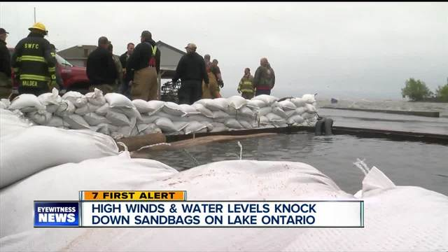 High winds - water levels knock down sandbags on Lake Ontario