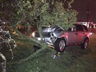 Woman strikes tree with SUV charged with DWI