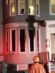 Residents escape overnight row house fire