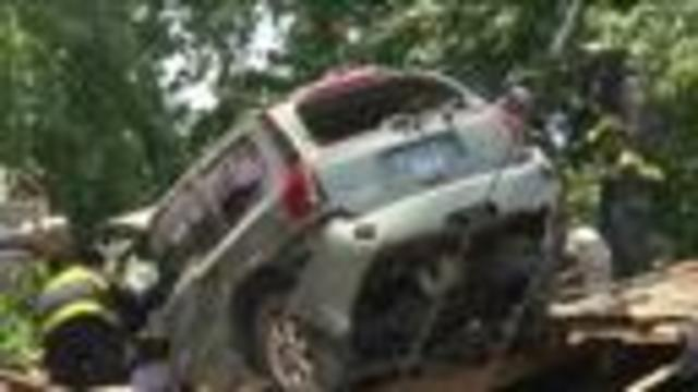 Homeowner escapes death as a flying auto crash-lands onto his home's roof