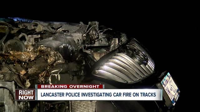 Lancaster police investigating overnight car fire on train tracks