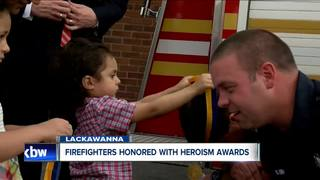 Firefighters honored for saving two children