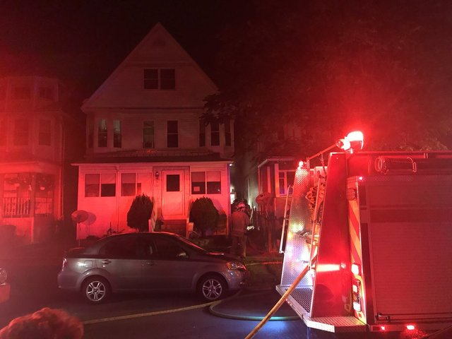Seven people forced out of rooming house by fire