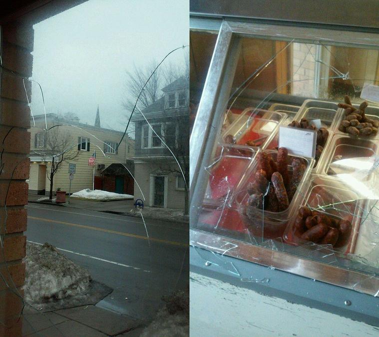 Brick thrown through meat market's window