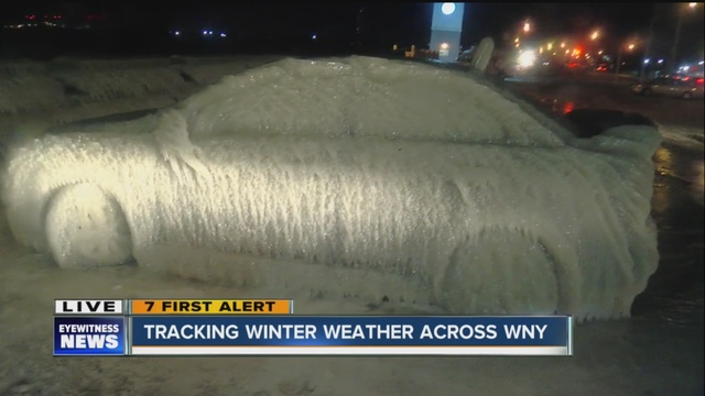 car parked by lake erie covered in ice
