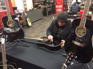 Win a guitar signed by Robby Takac