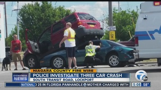 Three-car crash ends with car under SUV