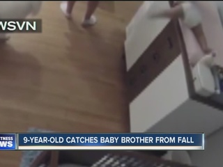 Boy catches baby from changing table fall