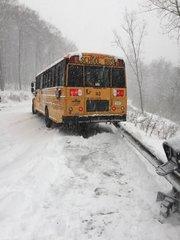 School bus hits guardrail in snowy weather