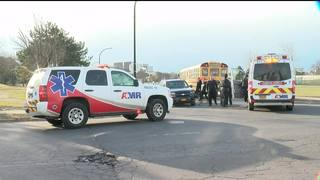 Kids walk to school after bus and car collide