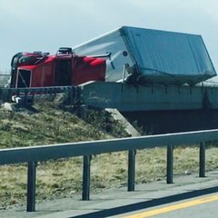 3 tractor trailers on their sides due to winds