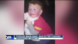 Mother of toddler killed by babysitter charged