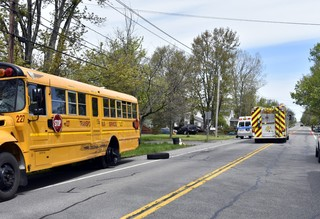 Five students injured after SUV sideswipes bus
