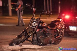 Two people hurt in motorcycle vs. car crash