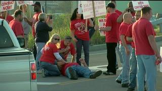 Person hit by car during picket at DuPont Plant