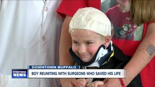 Boy reunites with doctors who saved his life