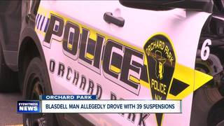 Man found passed out behind wheel arrested