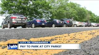 City discusses charging a fee for park parking