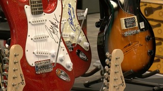 Autographed guitars help raise money for charity